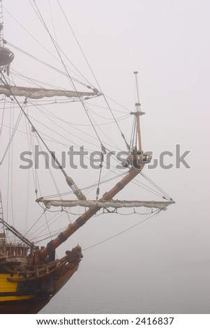 Sailing-ship embark on an unchartered sea.Way through the mist.
