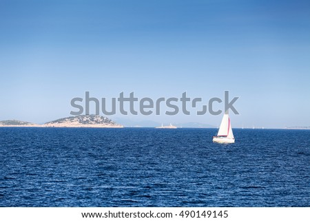 Sailing ship in Adriatic sea water with hill on background
