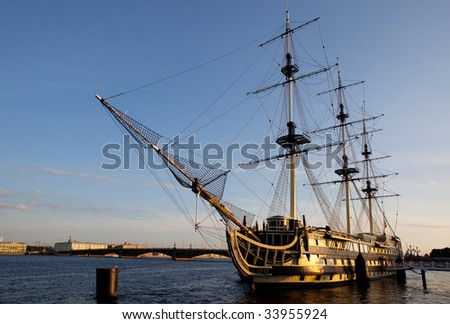 Sailing ship in harbor.