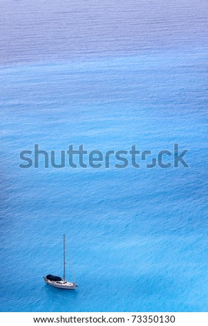 sailing ship in the amazing cyan colored ionian sea.