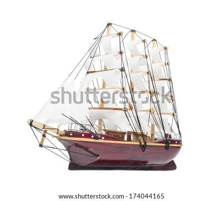 Sailing ship model isolated on white background - stock photo