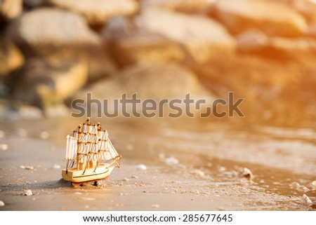 Sailing ship model on the beach, discovery concept   - stock photo