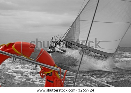 Sailing ship on a cruise - BW version, red life vest - stock photo