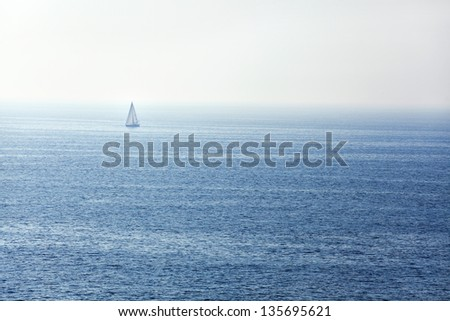 sailing ship on the blue ocean