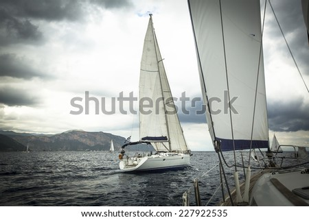 Sailing ship yachts during regatta in the sea in stormy weather. - stock photo