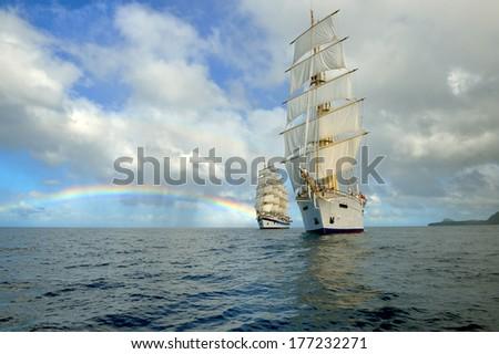 Sailing ships and rainbow - stock photo