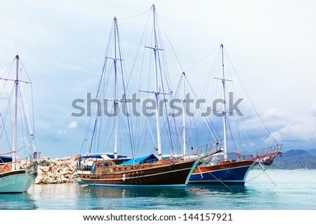 sailing ships in the sea bay - stock photo