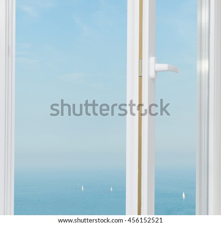 sailing ships in the sea outside the window