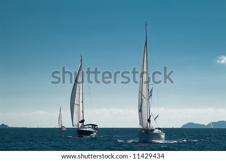 sailing ships on a cloudy day near ground
