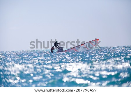 sailing team fighting to save the ship from overturn - stock photo