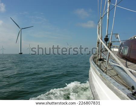 sailing through a wind park - stock photo