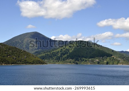 Sailing through Cook strait between North and South Islands of New Zealand. - stock photo