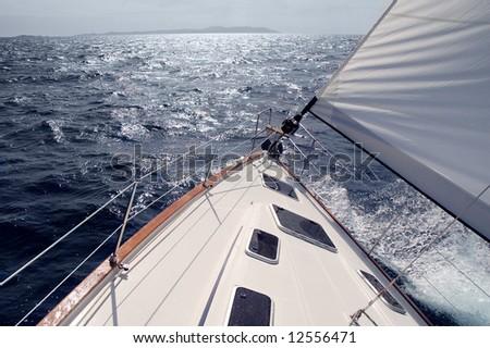 Sailing toward sun on a late winter day - stock photo