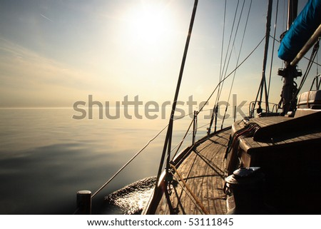 Sailing towards sun - stock photo