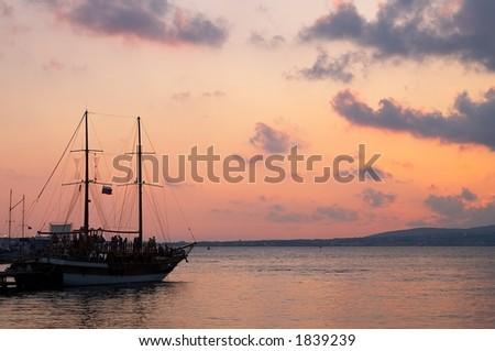 sailing vessel after sundown - stock photo