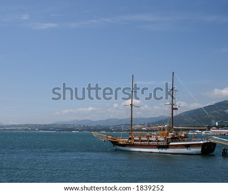 sailing vessel in natural harbour - stock photo