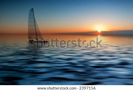 Sailing with a beautiful sunset - stock photo
