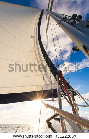 Sailing yacht boat on ocean water against sunset. Travel Concept. - stock photo