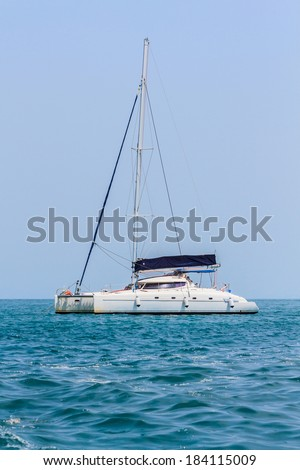 Sailing yacht boat on tropical sea on blue sky background,Thailand. - stock photo