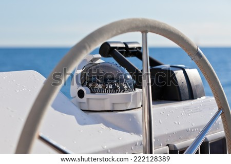 Sailing yacht control wheel and implement. Horizontal close up shot without people - stock photo