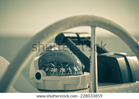 Sailing yacht control wheel and implement. Horizontal shot without people. Filtered. - stock photo