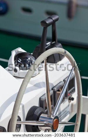 Sailing yacht control wheel and implement. Vertical shot without people - stock photo
