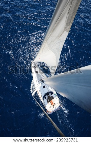 Sailing Yacht from mast at sunny day with deep blue ocean - stock photo