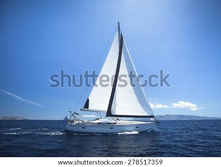 Sailing Yacht from sail regatta race on blue water Sea. - stock photo