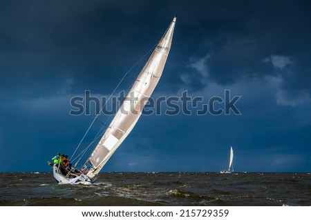 Sailing yacht in a stormy weather - stock photo