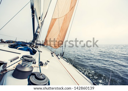 Sailing yacht on the race - stock photo