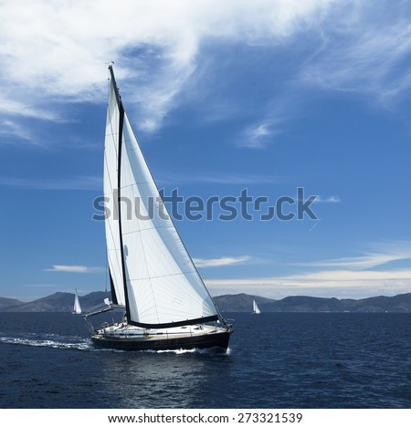 Sailing. Yacht sails with beautiful cloudless sky. Luxury yacht. - stock photo