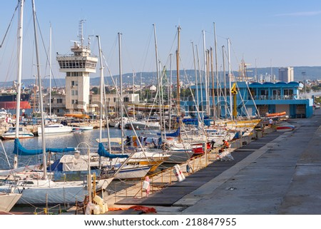 Sailing yachts and pleasure boats stand moored in port of Varna, Bulgaria - stock photo