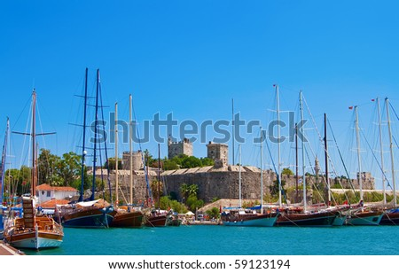 sailing yachts in Bodrum, we can also see an old castle - stock photo
