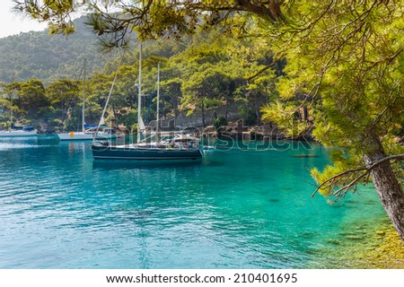 Sailing yachts stay at anchor at calm bay - stock photo