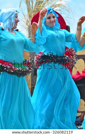 SAILLON, SWITZERLAND - SEPTEMBER 11: Dancers from the Moroccan Tornals group performing in the Saillon Medieval Festival: March 11, 2015 in Saillon, Switzerland - stock photo
