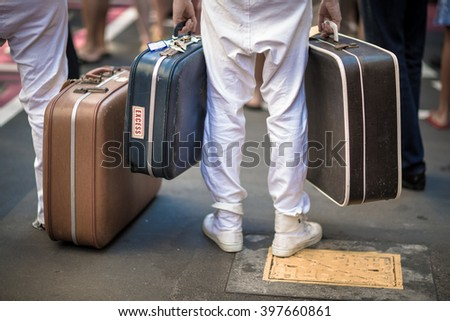 sailor carrying vintage suitcases - stock photo
