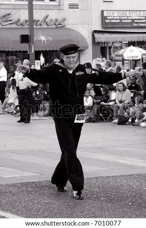 Sailor dancing in Veterans' Day parade