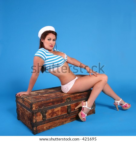 Sailor girl sitting on an old wodden trunk. Done in a modern pin-up style - stock photo