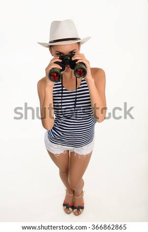 Sailor girl with binocular. Pretty woman with binocular isolated on white background. Lady looking through binocular. - stock photo