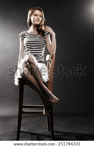 Sailor girl Woman in striped vest style Sailor woman sitting in short skirt - stock photo