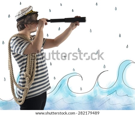 Sailor looks at the sea with the telescope - stock photo