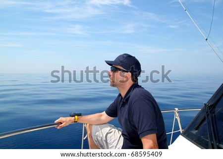 Sailor man sailing boat blue calm ocean water Mediterranean sea