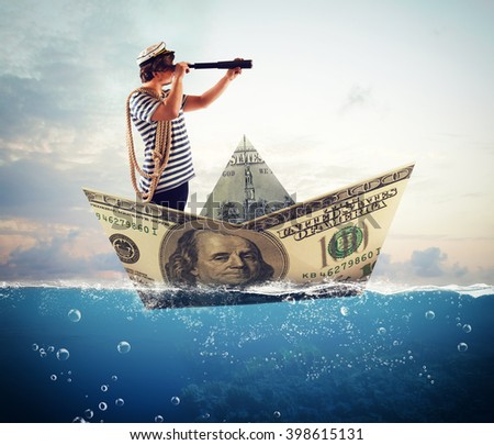 Sailor on banknote boat - stock photo