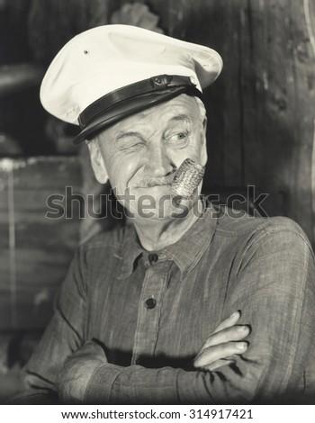 Sailor smoking corn pipe - stock photo