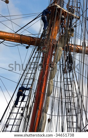 Sailors at masts of sail ship