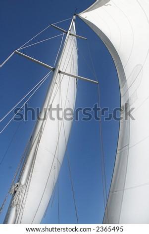 Sails against a blue sky. - stock photo