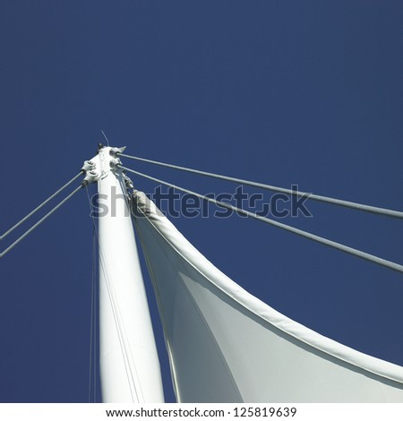 Sails and blue sky - stock photo