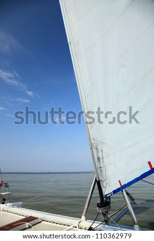 Sails and mast in the blue sky