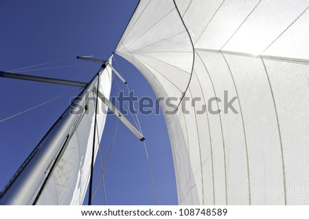 Sails and mast over blue sky background