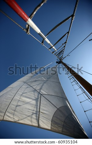Sails in the blue sky - stock photo